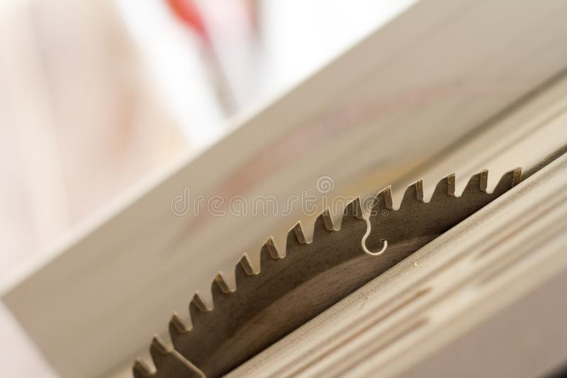 Close-up of teeth and disk surface of a circular saw, selective focus. Closeup of teeth and disk surface of a circular saw, selective focus royalty free stock photo