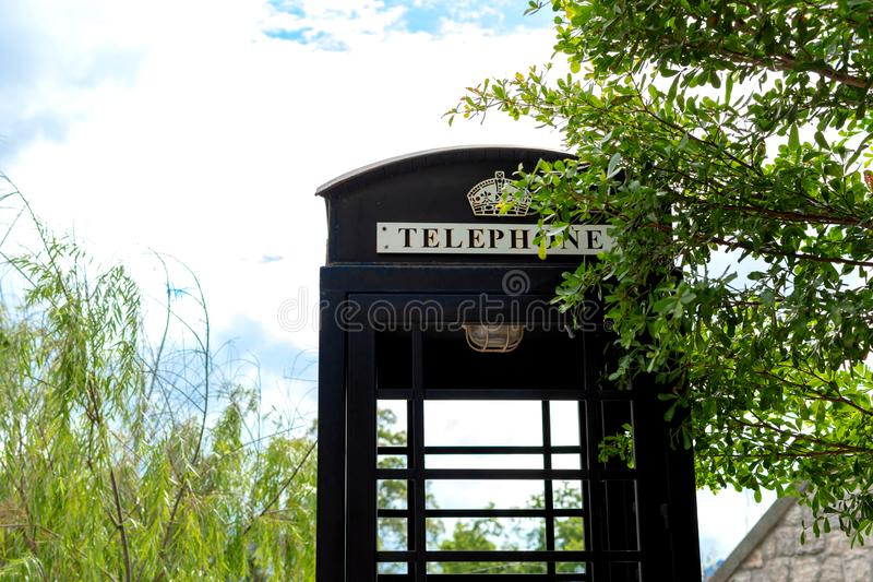 Close up of vintage telephone booth in a garden with copy space. Close up of telephone booth in a garden with copy space stock images