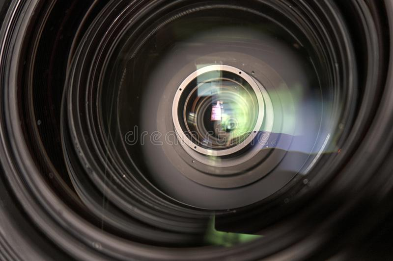 Close up of a television lens  on a dark background stock image