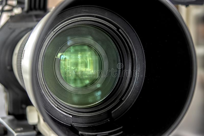 Close up of a television lens  on a dark background royalty free stock image