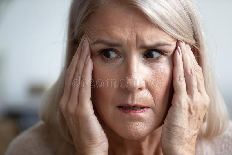 Close up of scared elderly woman having panic attack royalty free stock photos