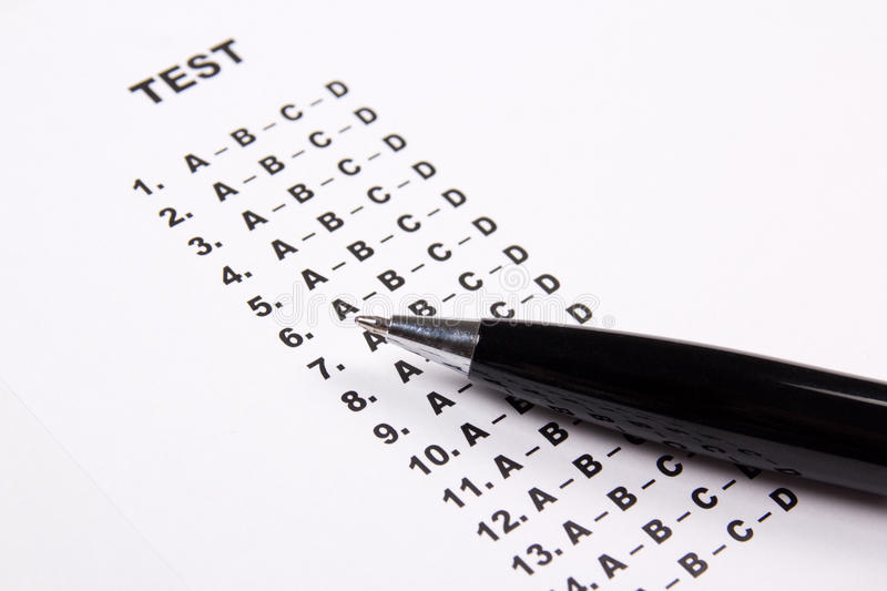 Close up of test score sheet paper with answers and pen royalty free stock photography