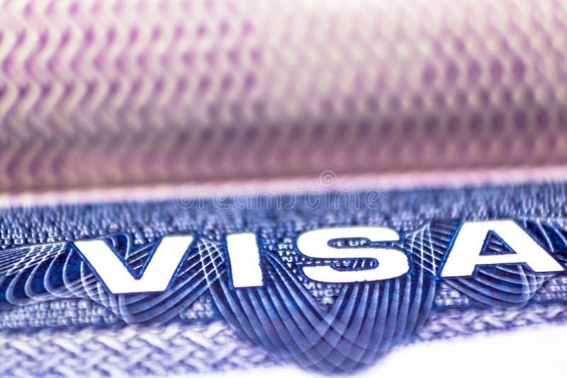 Close up of text visa on USA visa stamp in passport.  stock photo