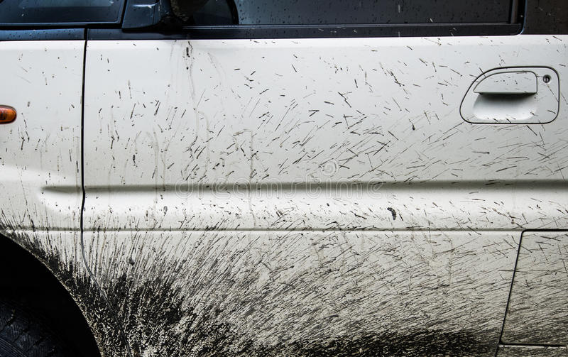 Close-up texture background splashes of mud on a white car.  stock image