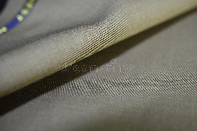 Close up texture brown gold fabric of suit. Photo shoot by depth of field for object royalty free stock photo