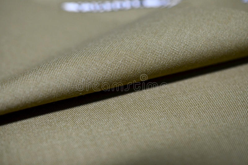 Close up texture light brown gold fabric of suit. Photo shoot by depth of field for object stock photos