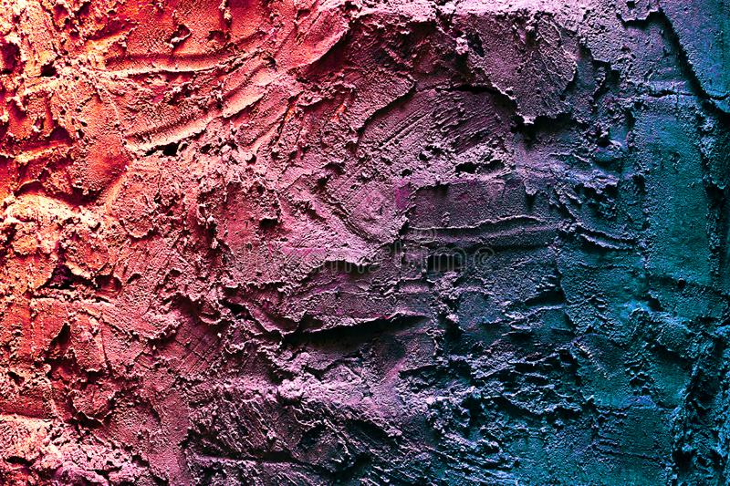 Close up texture of multicolor embossed plaster on the wall stock image