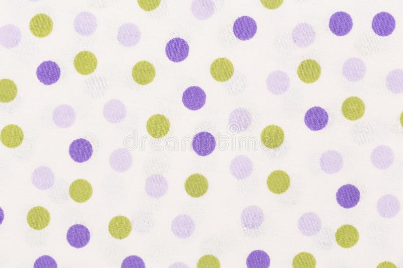 Close up of texture with orange and purple dots on white backgro stock photography