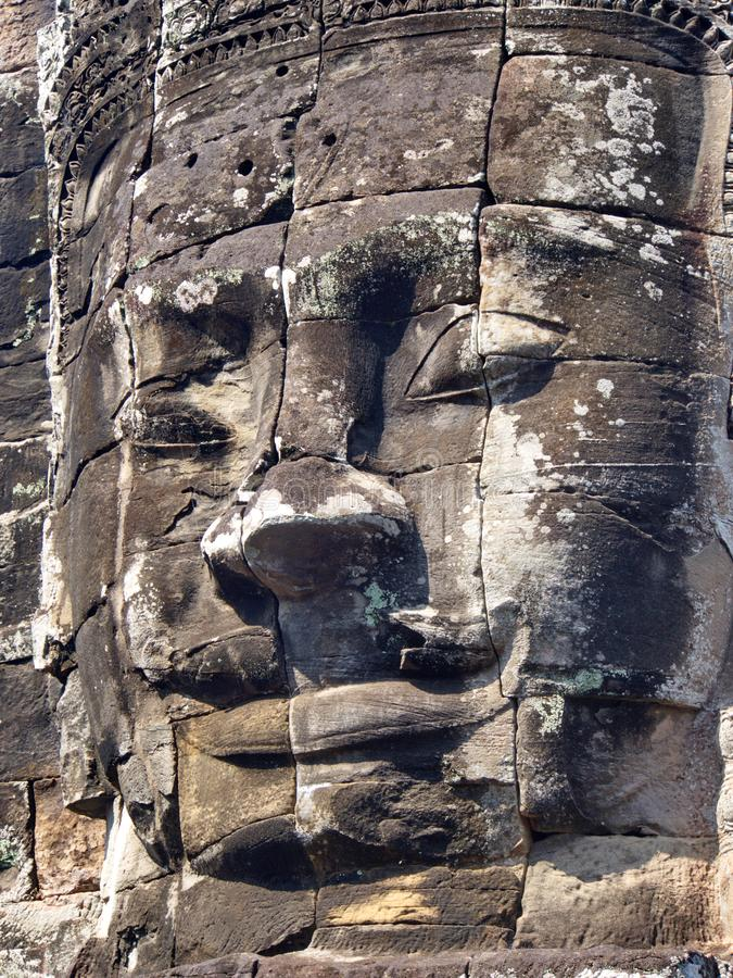 Close-up texture of stone carving in the Temple of Angkor Wat in Seam Reap City, Cambodia in 2012 , 9th December. Close-up texture of stone carving in the Temple royalty free stock image