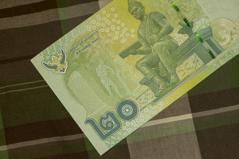Close up of Thai banknote Thai bath with the image of Thai King. Thai banknote of 20 Thai baht on Green Scottish fabric. stock photo