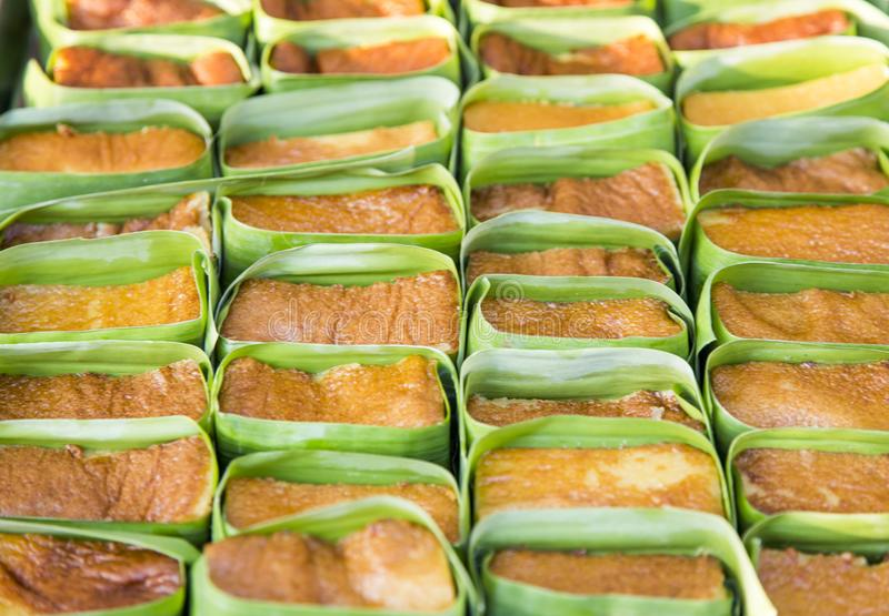 Thai custard dessert with banana leaf in bakery stock image