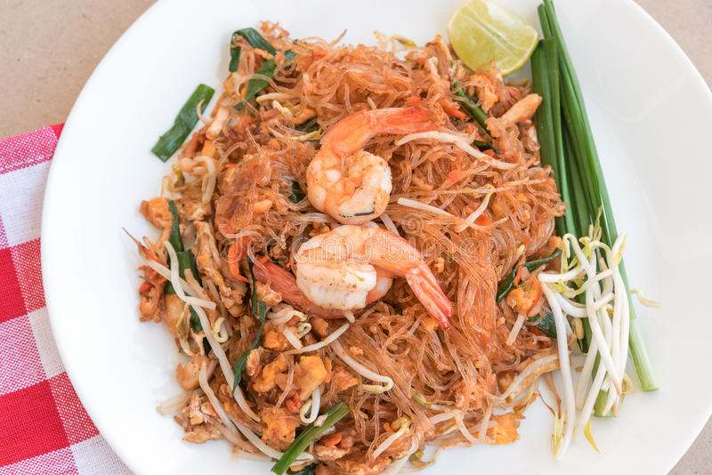 Close-up thai noodle or padthai, Thailand traditional food and b. Close-up thai noodle or padthai, garnish, vegetable, shrip, Thailand traditional food and blur stock photo