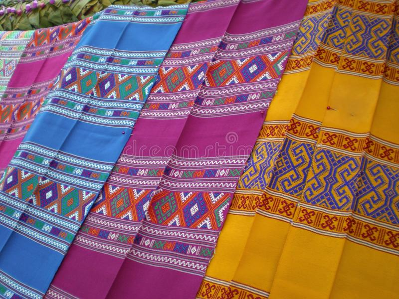 Thai silk pattern, design, texture, thread, cocoon, tool and equipment. Close up the thai silk pattern, design, texture, thread, cocoon, tool and equipment stock photo