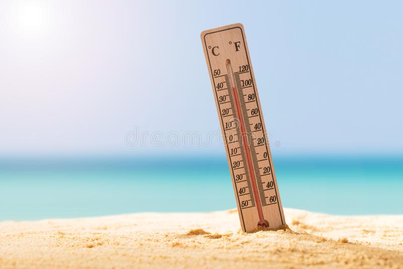 Close-up Of Thermometer On Sand royalty free stock photos