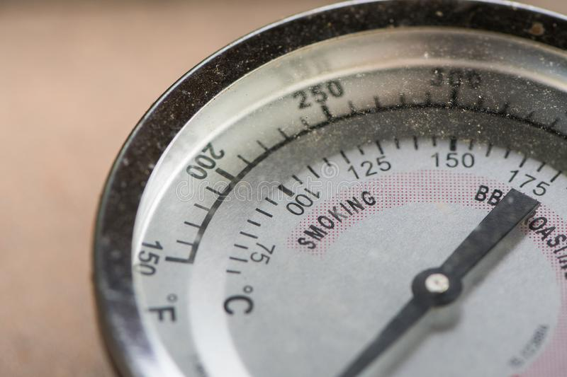 Close up of thermometer on smoking grill stock image