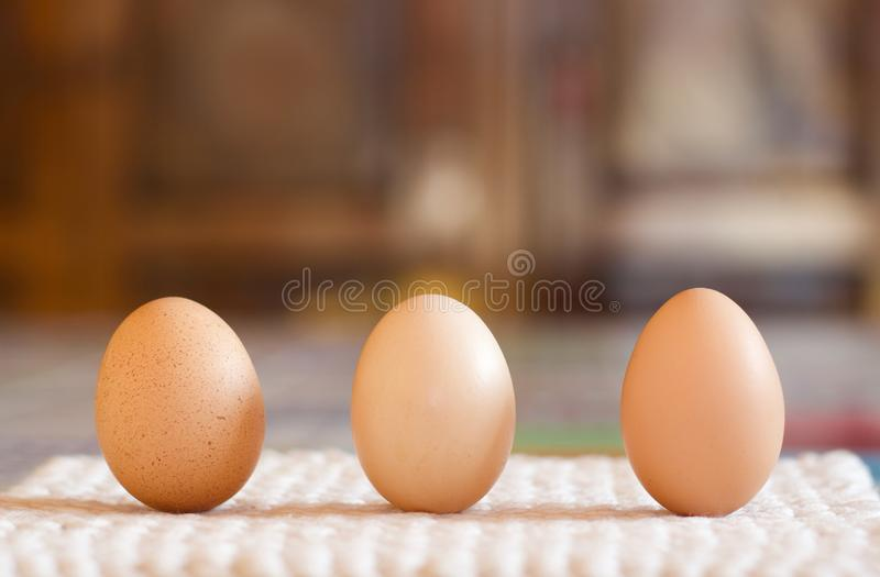 Close up of three chichen eggs on the table royalty free stock image