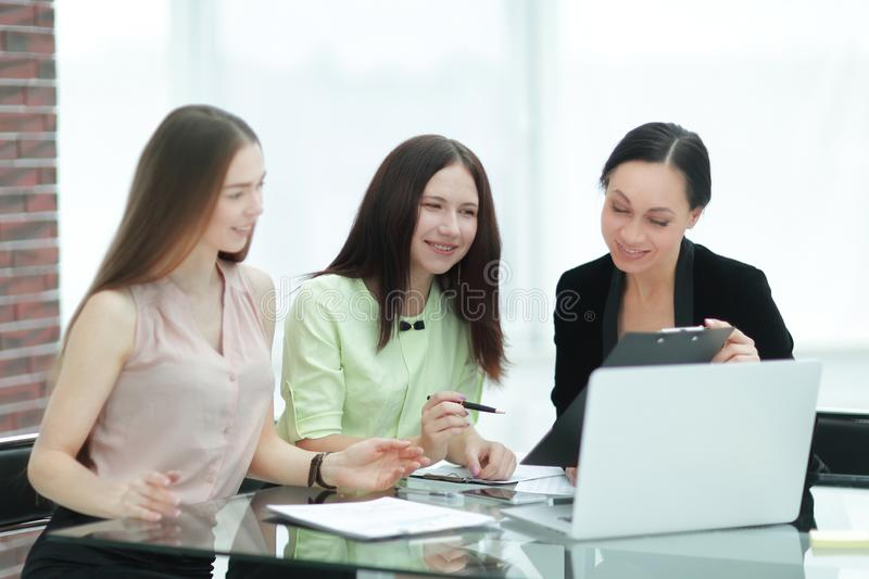 Close up.three employees of the company work with documents at the table in the office.  royalty free stock photos