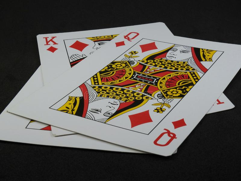 Three playing cards. We can see the King and the Queen of Diamonds. stock photo