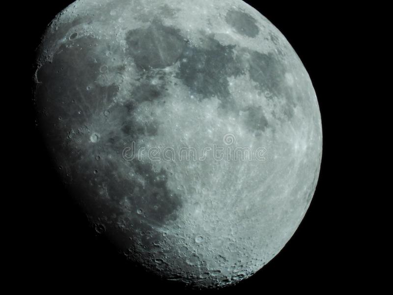 close-up of a three-quarter moon in the night sky stock images