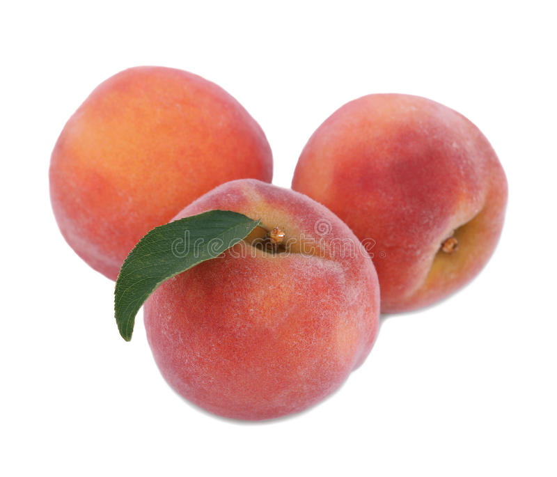 Close-up of three tasty colourful peaches, isolated on a white background. Juicy beautiful fruit of peaches, full of vitamins. stock photo