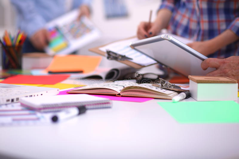 Close-up of three young creative designers working stock photo
