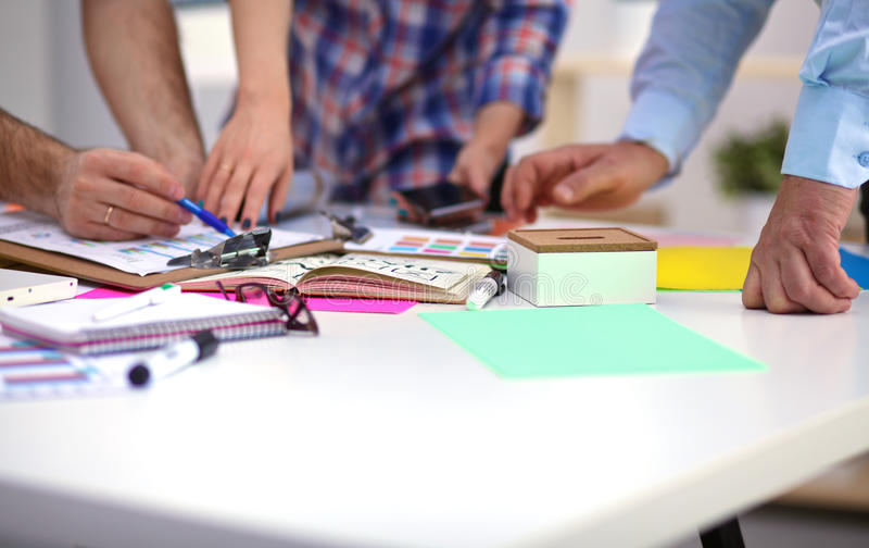 Close-up of three young creative designers working royalty free stock image