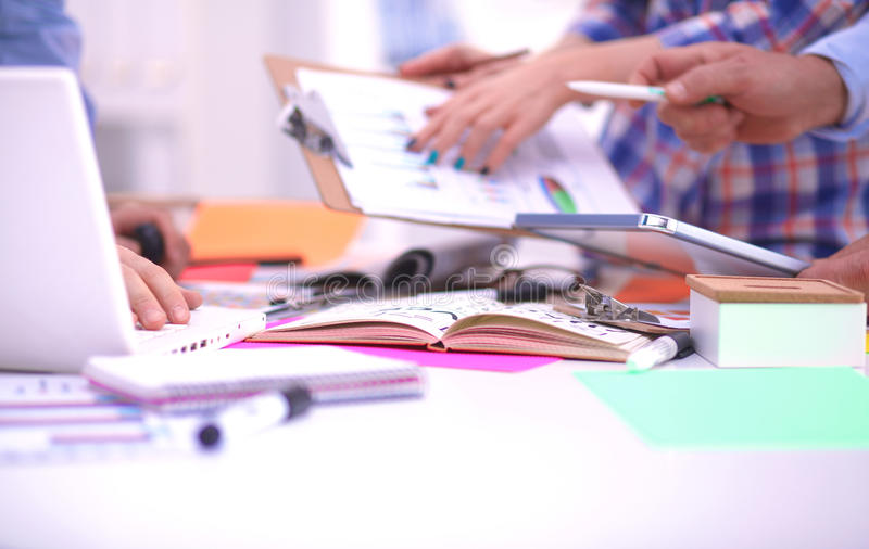 Close-up of three young creative designers working stock photography