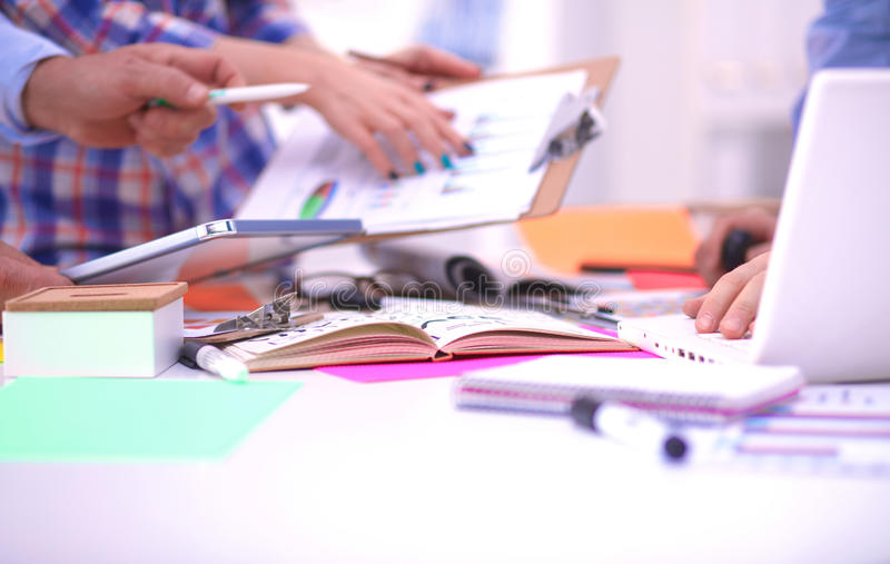 Close-up of three young creative designers working on project together. Team work royalty free stock photography
