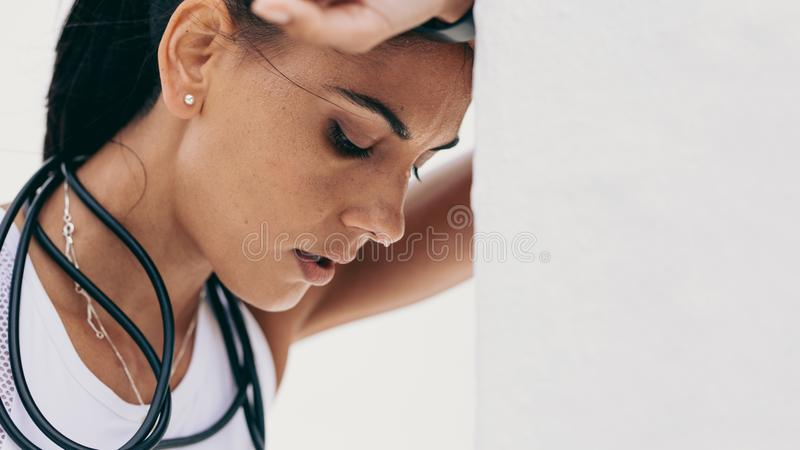 Close up of a tired fitness woman stock photo