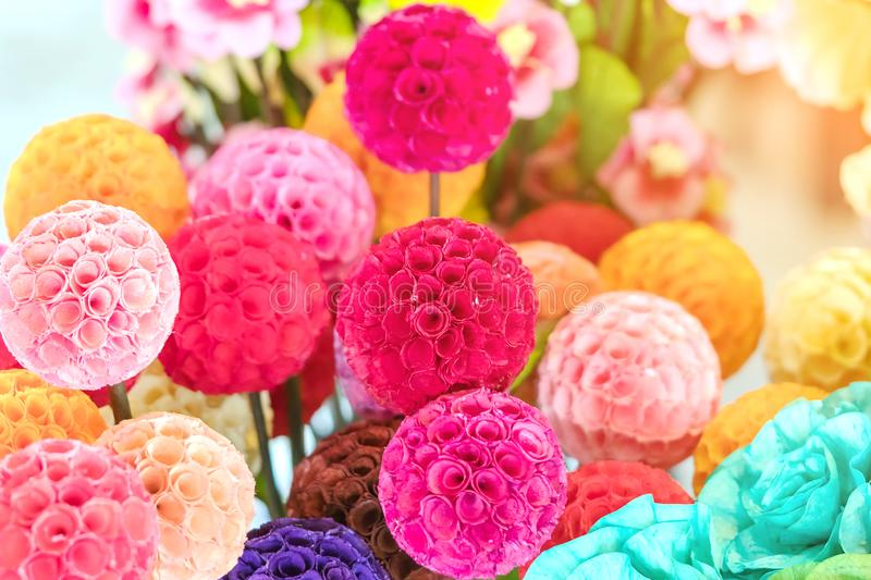 Close up to beautiful decoration artificial flower or faked flowers for sale at local market. stock photos