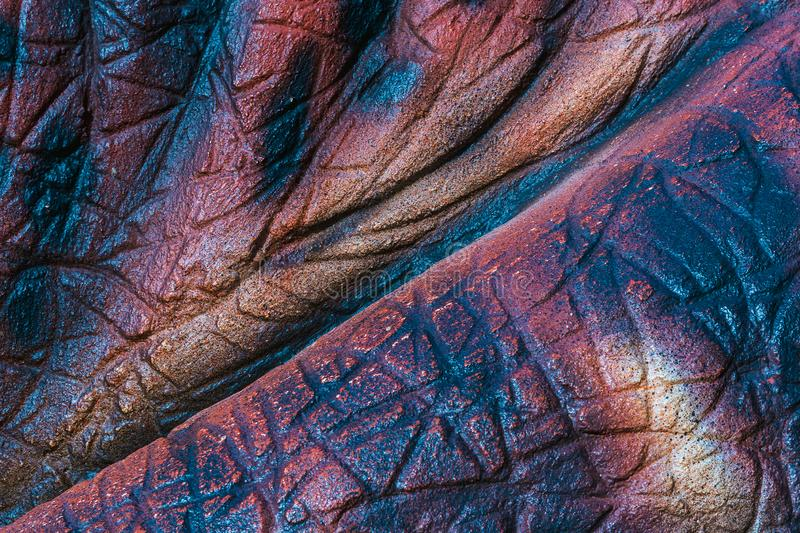 Close up to Colorful and patterns of dinosaur model surfaces. Close up to Colorful and patterns of  dinosaur model surfaces created with cement stock photo