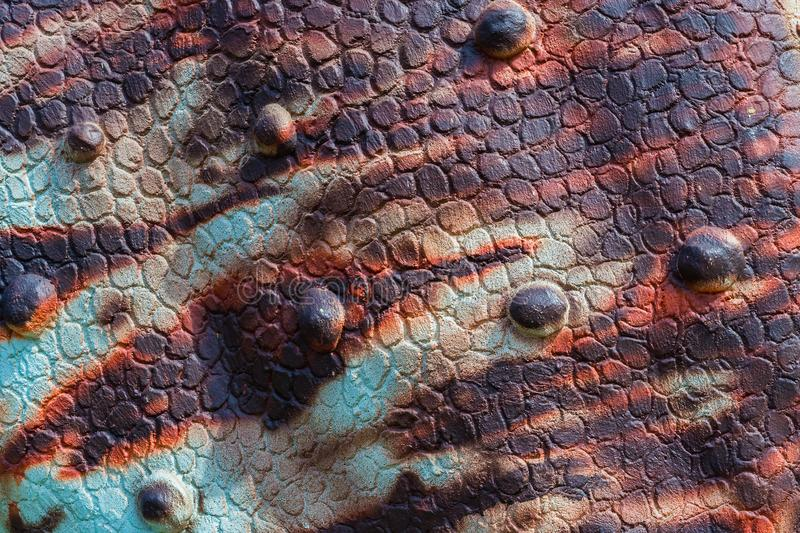 Close up to Colorful and patterns of dinosaur model surfaces. Close up to Colorful and patterns of  dinosaur model surfaces created with cement stock photos