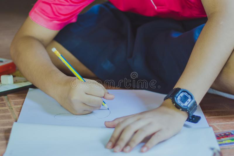 Close up to hands of Student practice drawing stock photos