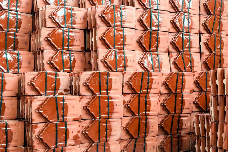 Close up to many pile of roof tiles traditional clay stack for a Buddhist Temple restoration in vintage style stock photography