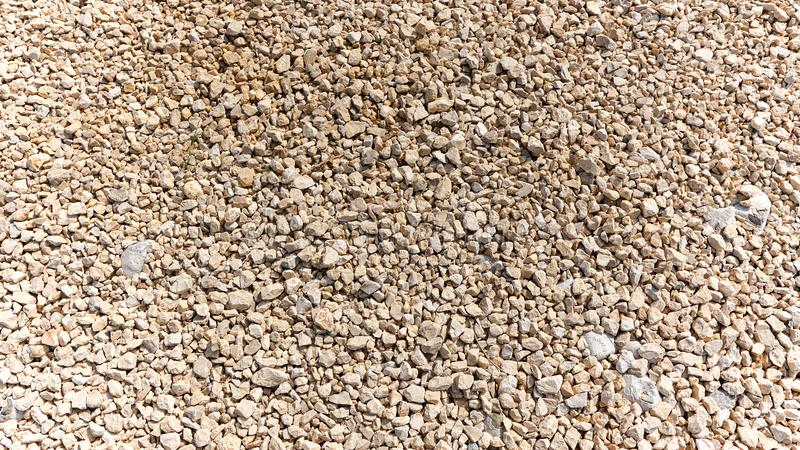Close up to small stones and rocks, shot at the bright day. Close up to small stones and rocks grey, white, yellow color shot at the bright day stock images