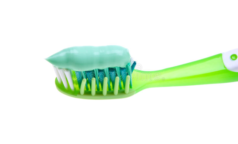 Close-up of a toothbrush with paste on white. Close-up of a toothbrush with paste isolated on white background royalty free stock photography