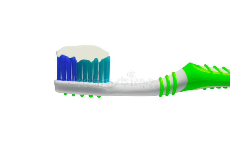 Close up toothbrush with white creamy toothpaste isolated on white. Close up toothbrush with white creamy toothpaste isolated on white background stock photos