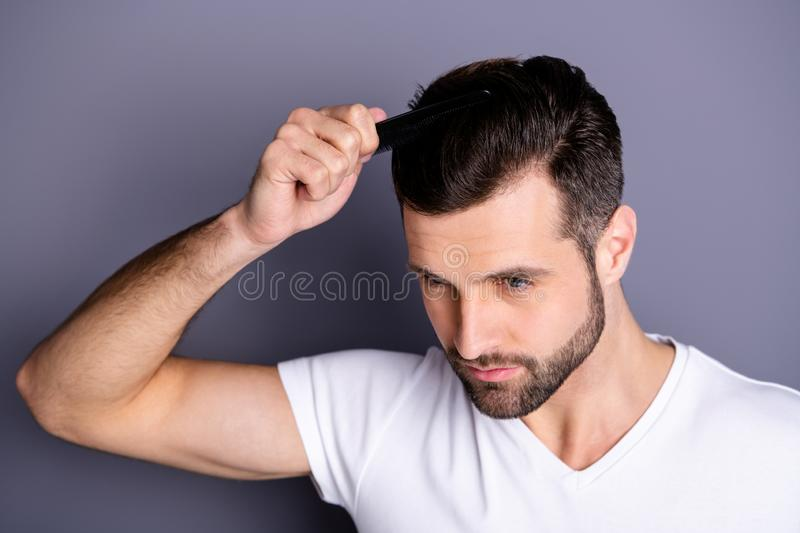 Close up top above high angle photo amazing he him his macho hands arms plastic hair styling brush take care hairdo. Close up top above high angle photo amazing royalty free stock photos