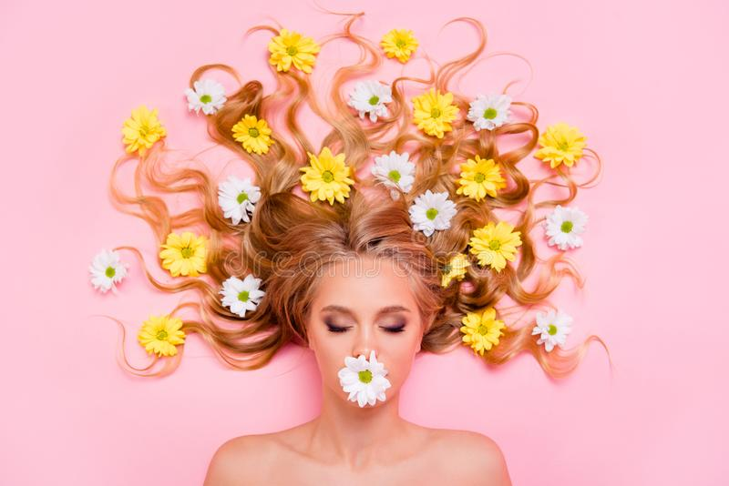 Close up top above high angle view photo beautiful she her lady hide mouth lips not speak tell talk lying down flowers stock image