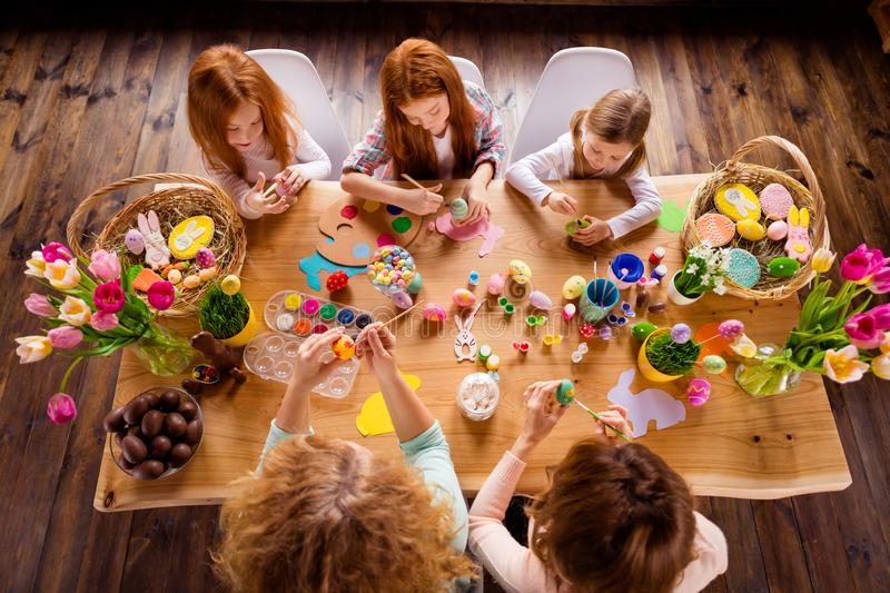 Close up top above high angle view photo group five family making decorating eggs easter symbols weekend children day royalty free stock photos