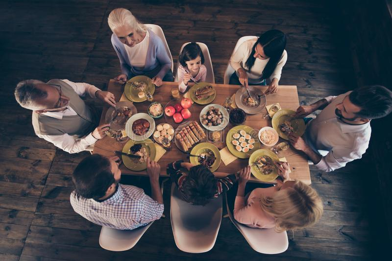 Close up top above high angle view photo people family thanksgiving conversation members company brother sister granny stock photography
