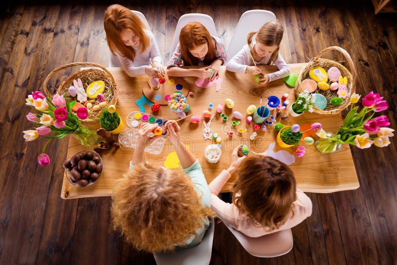 Close up top above high angle view photo three children one room making decorating eggs easter symbols weekend children royalty free stock images