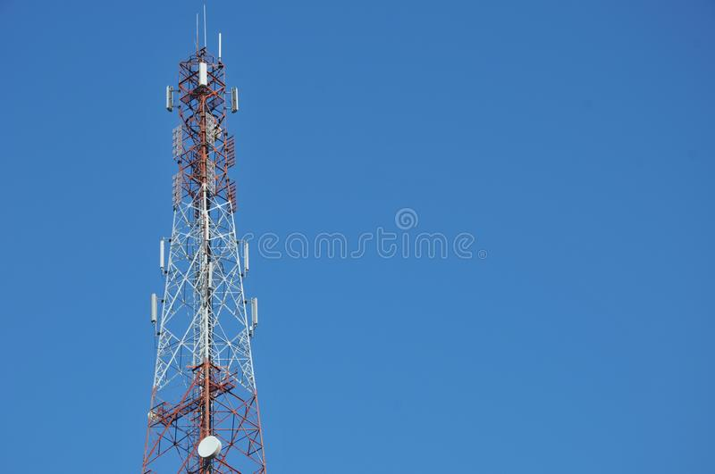 Close up top of communication Tower with antennas such a Mobile phone tower, Cellphone Tower. Phone Pole etc stand on the mountain on white sky background stock images