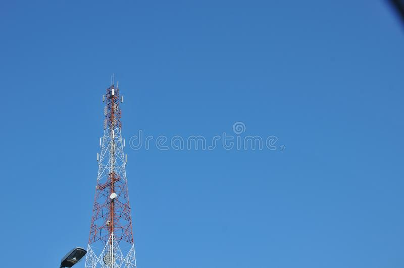 Close up top of communication Tower with antennas such a Mobile phone tower, Cellphone Tower. Phone Pole etc stand on the mountain on white sky background stock image
