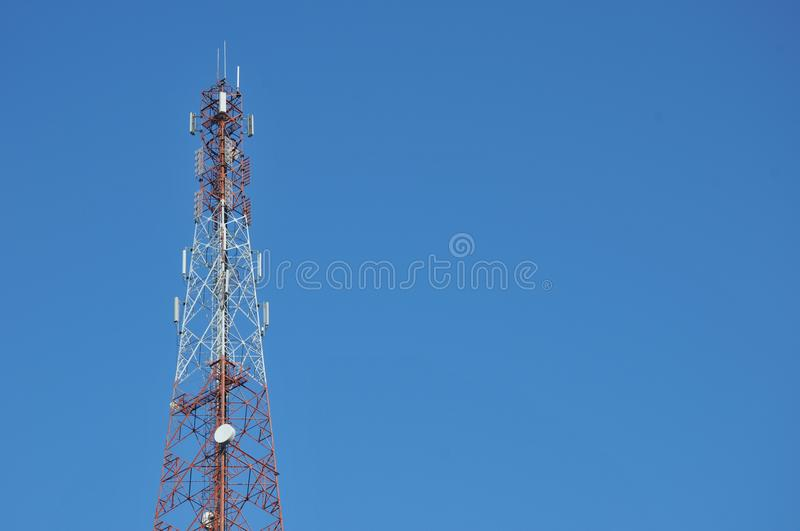 Close up top of communication Tower with antennas such a Mobile phone tower, Cellphone Tower. Phone Pole etc stand on the mountain on white sky background stock photography