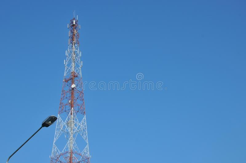 Close up top of communication Tower with antennas such a Mobile phone tower, Cellphone Tower. Phone Pole etc stand on the mountain on white sky background stock photo