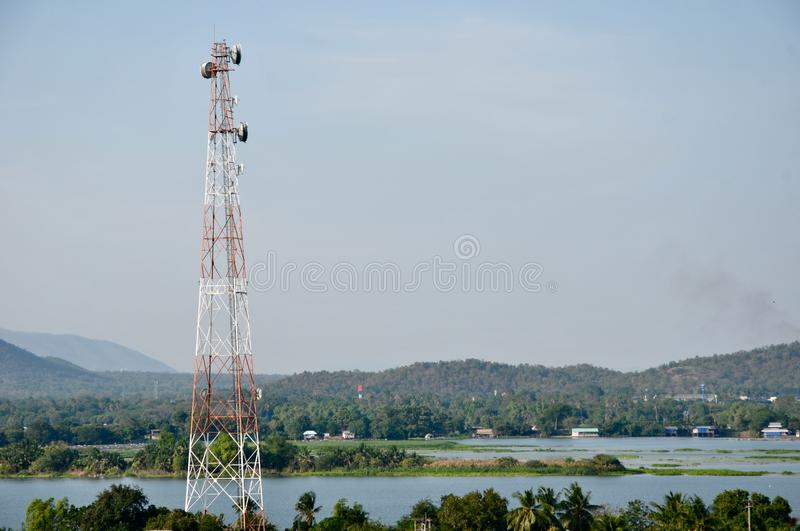 Close up top of communication Tower with antennas such a Mobile phone tower, Cellphone Tower. Phone Pole etc stand on the mountain on white sky background royalty free stock image