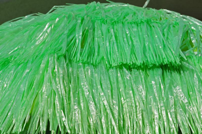 Green plastic fringes at a canopy stock photo