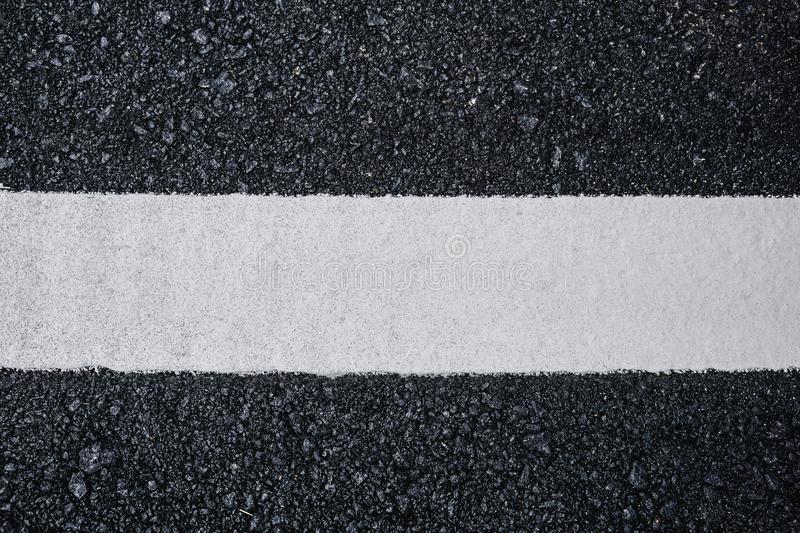 Top view close up texture background of asphalt road with white line royalty free stock images