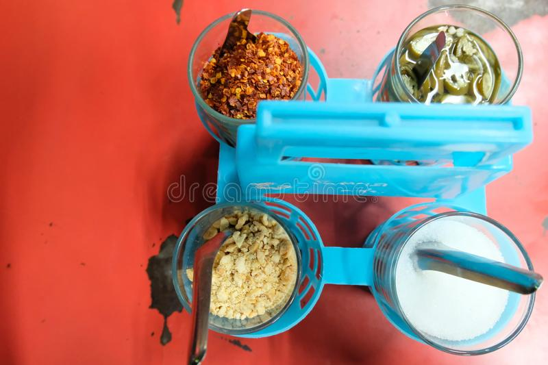 Close up top view Condiments set in Thailand street Food. Condiments set sugar, pepper, vinegar, and groundnut for Thai food or. Close up top view Condiments stock images